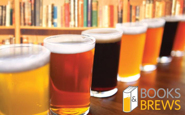 Beer glasses lined up in front of book shelves