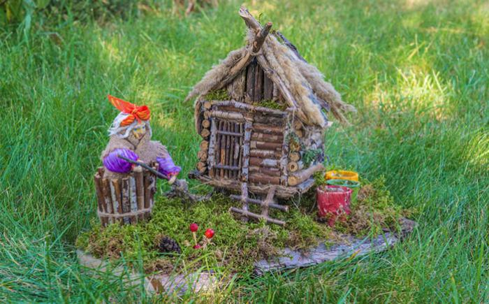 Small house, made from twigs and grasses, outdoors