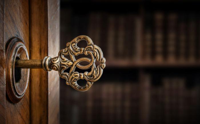 Ornate key in a lock