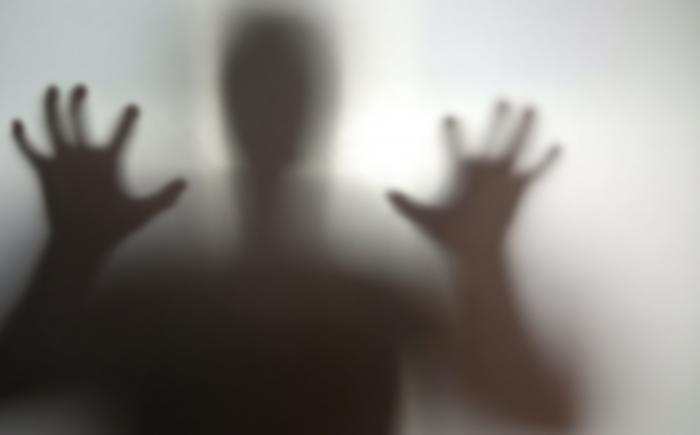 Mysterious silhouette with hands outstretched