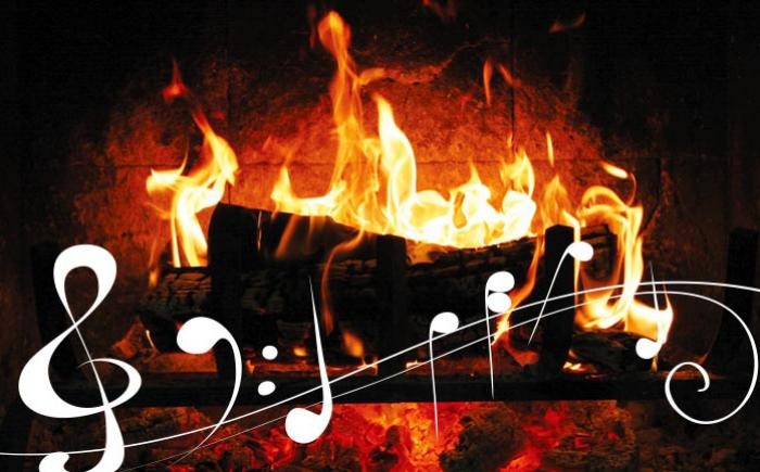 Log burning in a fireplace with musical notes