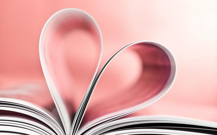 Book pages form a heart shape