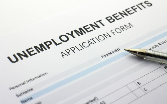 Unemployment Benefits form with pen