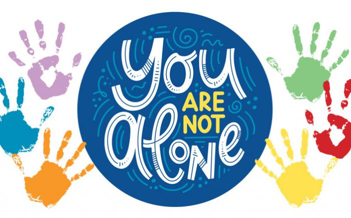 The words You Are Not Alone are surrounded by multi-colored handprints