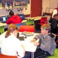 Northwest Library Homework Help Center filled with students and adult volunteers.