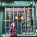 Cora S standing in front of Flourish and Blotts bookstore