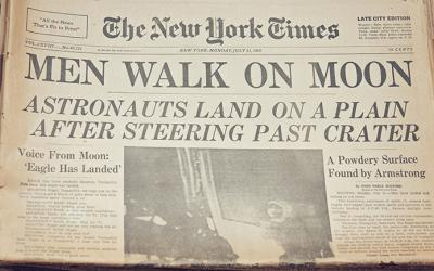 New York Times newspaper with Men Walk on Moon headline