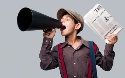 Newspaper boy shouting through megaphone