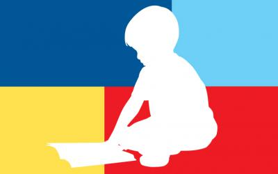 Silhouette of a child reading