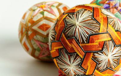 A sphere intricately wrapped with thread