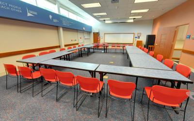 Tables and chairs set up inside the Northwest Library meeting room