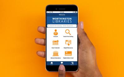 Hand holding smartphone with Worthington Libraries mobile app