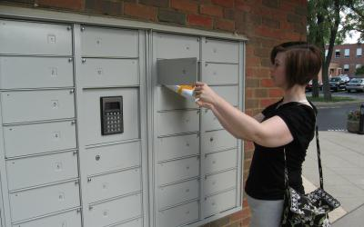 Woman using the pick-up lockers at Old Worthington Library