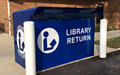 Blue bookdrop at Old Worthington Library