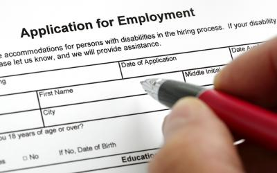 Person filling out job application