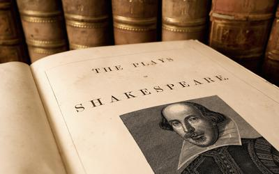 Open book with portrait of Shakespeare
