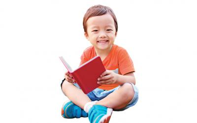 Preschool boy holding a book
