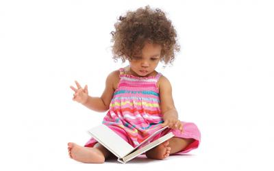 Toddler girl holding a book