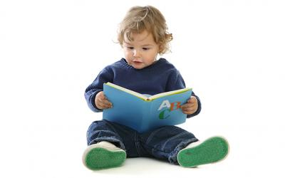 Toddler boy holding a book